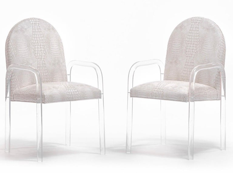Beautiful set of eight Charles Hollis Jones style lucite dining arm chairs freshly reupholstered in Ivory Crocodile Leatherette. Sexy and light, easy to clean and durable, the crocodile leatherette is a perfect choice for dining chairs. The chairs
