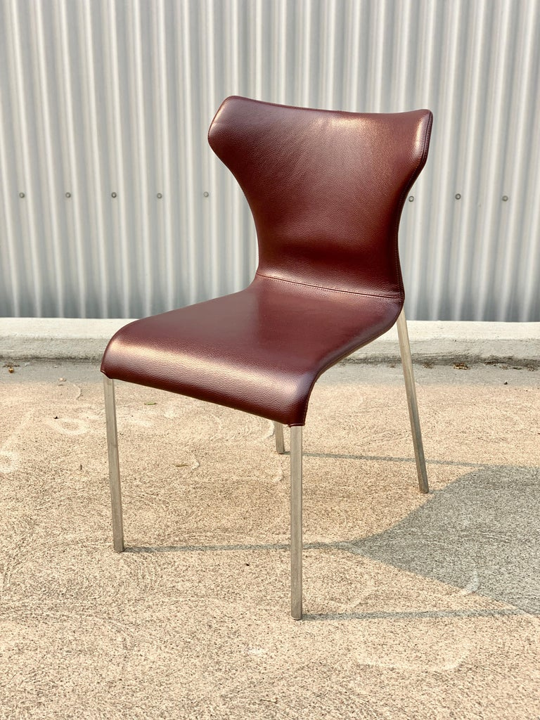 A set of eight butterfly chairs in oxblood leather, designed by Naoto Fukasawa for B&B Italia.