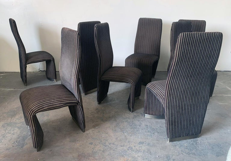 This set of 8 velvet Postmodern dining chairs is absolutely gorgeous. With an almost squiggle body frame and brushed nickel