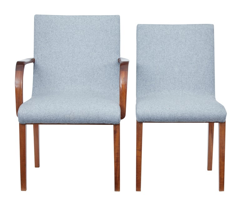 Fine quality set of dining chairs comprising of 2 armchairs and 6 single chairs, circa 1940.   We have just had this set upholstered in grey fabric with matching braid, which contrasts superbly with the warmth of the woodwork. Frames made from