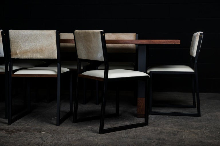 Here' s a set of 8 Shaker modern chair. They are handmade to order from our unique Ambrozia black textured steel tubing frame with a leather upholstered seat and Cow Hide Hair back. We have a large variety of leather and cow hide hair skin option.