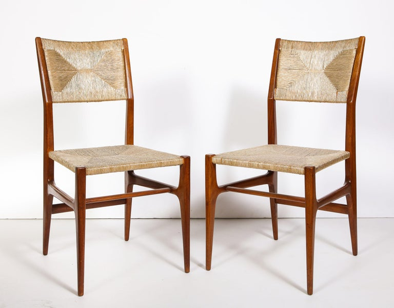 Solid mahogany frames with upholstered glossy coated twine seat and backrest.