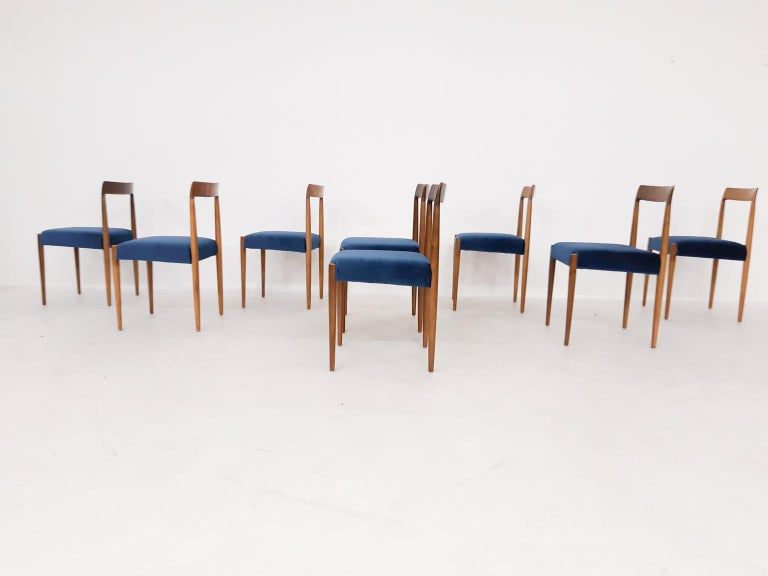 Set of 8 midcentury teak dining chairs by Lubke. Made in Germany in the 1960s.