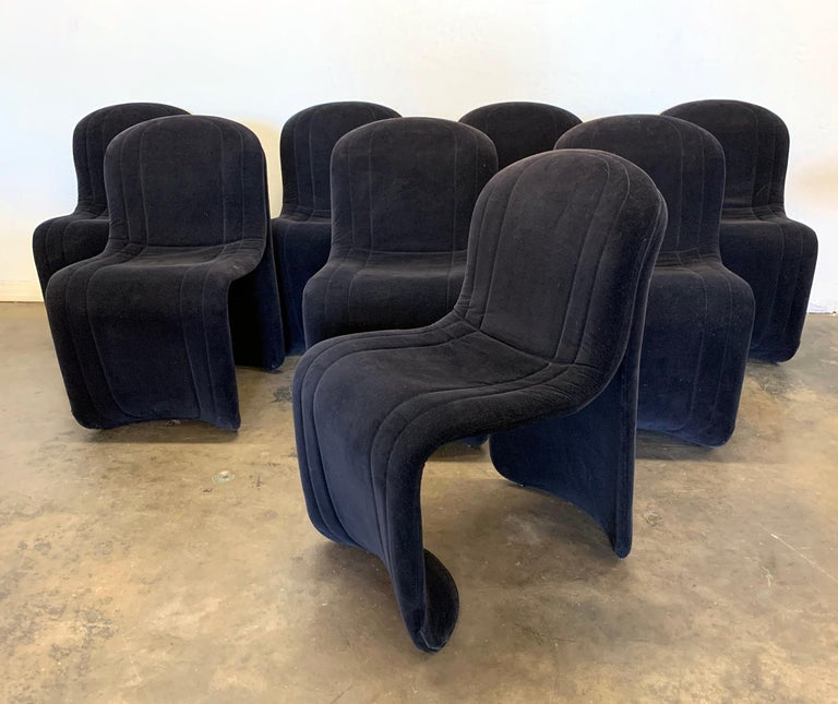This set of 8 Postmodern chairs are absolutely gorgeous! Upholstered in a luxurious black velvet, these curvy modern dining chairs are bound to bring a dash of style and elegance to any type of modern environment.