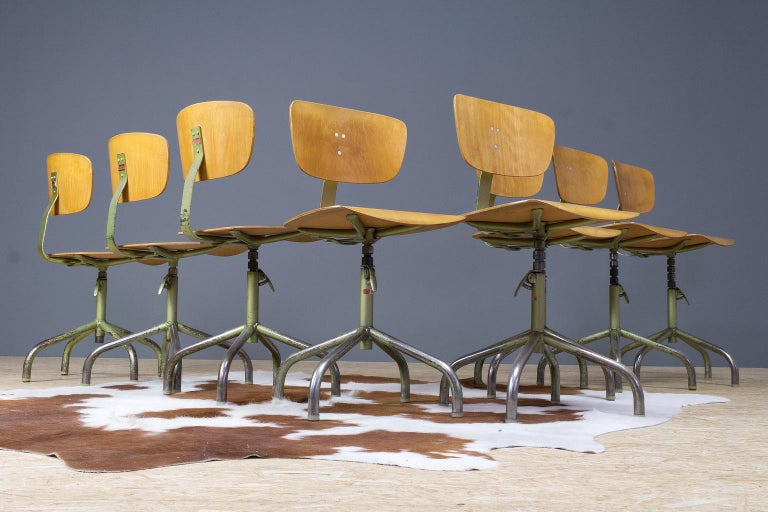 A set of 8 desk swivel chairs in metal an plywood, labelled 'Walter', Germany 1960s. The height is adjustable with an easy lever. Nice patina through use on the metal frames and legs as shown on photos. The green metal frame and plywood are in very