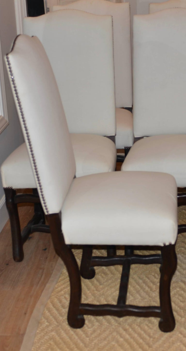 Set of eight French Os De Mouton oak dining chairs from Normandy, France. Very sturdy and comfortable.