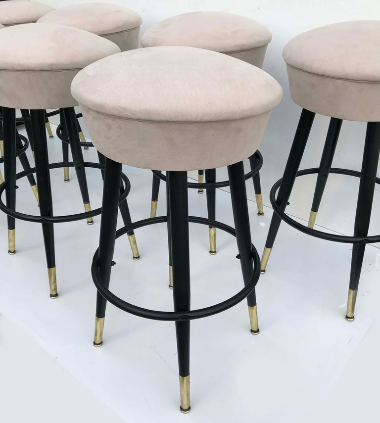 Superb set of 8 swiveling bar stools Newly restored and refinished New suede upholstery. Solid, heavy and sturdy Measures: Base 20