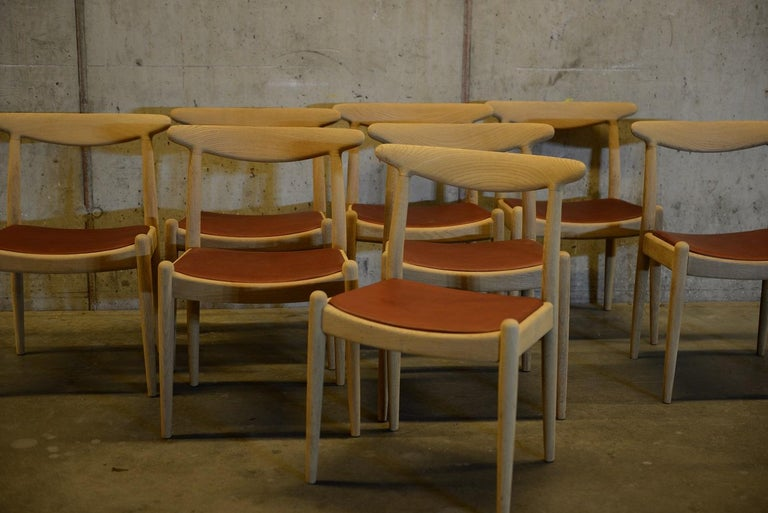 Set of 8 dining chairs in soaped oakwood with new leather seats. Newly re-upholstered with the finest cognac coloured leather from the Swedish Tärnsjö tannery. The chairs were designed by Danish designer Hans J. Wegner in the early 1950s. Produced