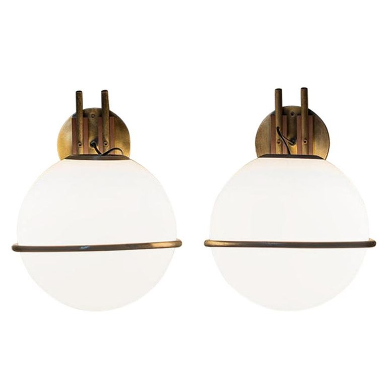 Stunning set of 9 glass and brass sconces in the style of Gino Sarfatti. Opaline glass ball holded by a brass structure. Very good vintage condition.
