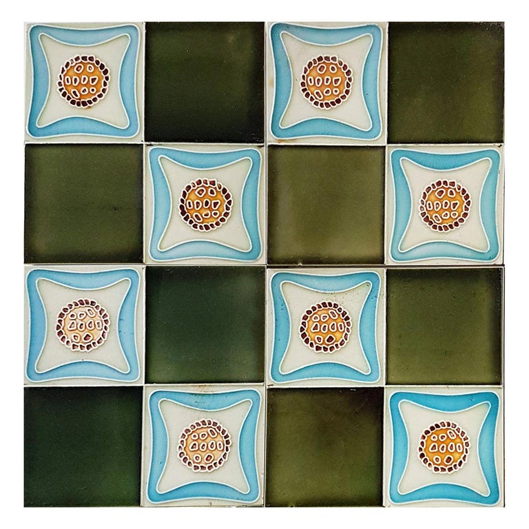 Recently lifted from its original home, this unique and antique set of Art Deco handmade tiles. A beautiful relief and color. With stylized design. These tiles would be charming displayed on easels, framed or incorporated into a custom tile