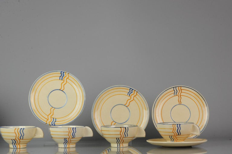 A lovely set of 4 Schramberg Germany tea cups Germany 1920s Art Deco.  Saucers and cups with some rimfritting. Size: 120mm and 167mm.