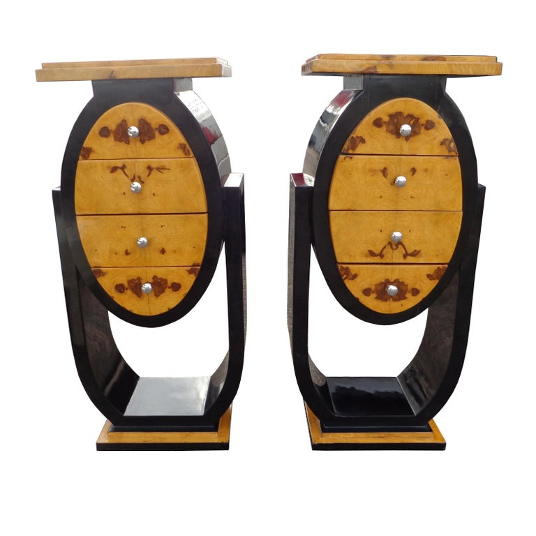 Set of Art Deco style nightstands side tables  Rich burl with ebonized cases on pedestal bases. 4 drawers with nickel pulls.