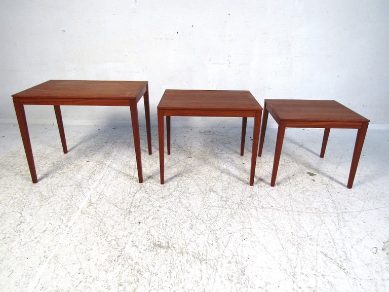 This elegant set of Danish nesting tables by Bent Silberg is perfect for any sitting room or accent room. With Minimalist construction, this set adds a bold sense of style without overpowering the space. Made to last these tables will be a beautiful