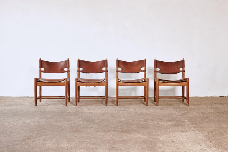 A set of four exceptional early Børge Mogensen Spanish dining chairsfor Fredericia Furniture, Denmark. Saddle leather on an oak frame, in original condition with super age and patina.     UK customers please note:    displayed prices do not include