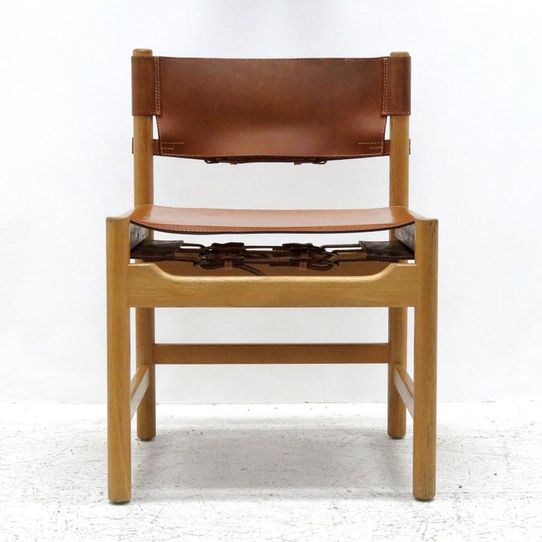 Wonderful set of eight Børge Mogensen dining chairs, model no. 577 for Karl Andersson & Söner, with saddle leather on oak frames, great patina.