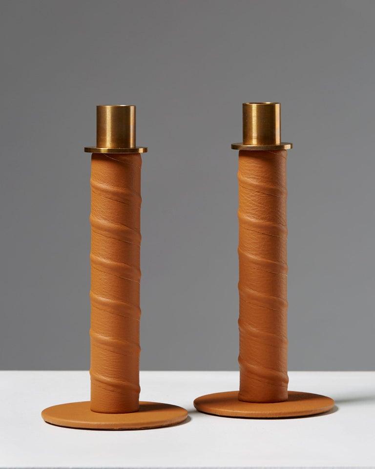 """Set of candlesticks """"Herrgård"""" designed by Alexander Lervik, Sweden, 2013. Steel, leather and brass.  Measure: Height 19 cm/ 7 3/8"""
