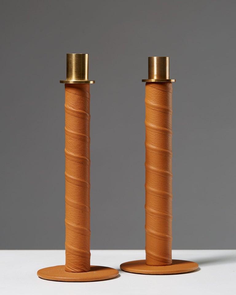 """Set of candlesticks """"Herrgård"""" designed by Alexander Lervik, Sweden, 2013. Steel, leather and brass.  Measures: H 19 cm/ 7 3/8"""