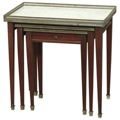 Set of Carrara Marble Top Directoire Style Mahogany Nesting Tables with Brass Ra