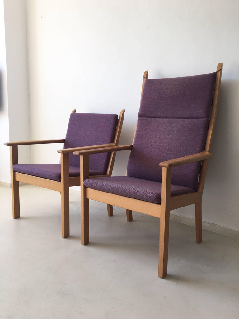 Rare set of chairs, consisting of an easy and a lounge chair, designed by Hans Wegner for GETAMA in 1984. They were produced, circa 1990s.  This set features a beautiful upholstery in pink/purple wool and a wonderful frame in oak. The chairs are