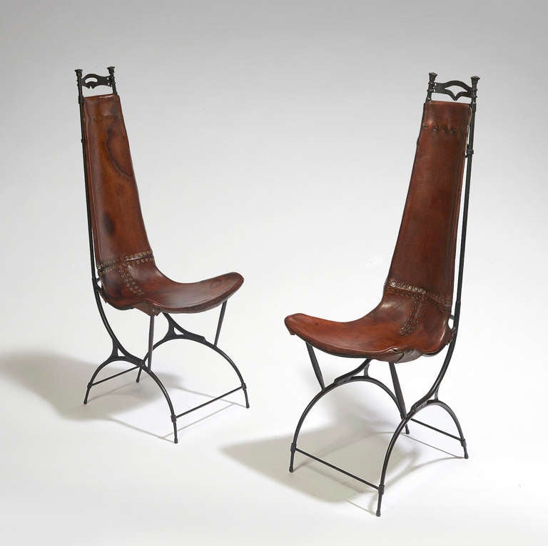 Set of five chairs with tall backrest Base structure in curved iron The seat is crafted from sturdy brown leather Stamped on the back.
