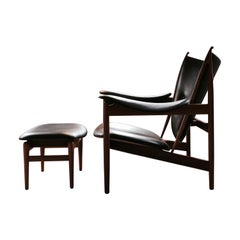 Set of Chieftain Armchair and Chieftain Stool in Wood and Leather by Finn Juhl