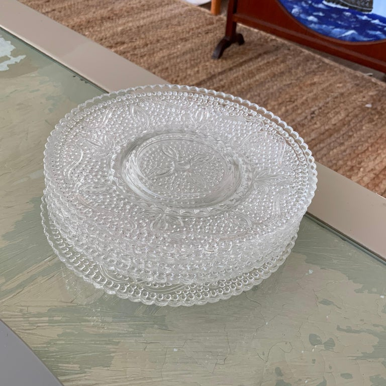 """A set of beautiful vintage cut glass salad plates. Layered over a dinner plate, or on it's own, these pieces will be a touch of classic elegance to any dinner table.   Dimensions: 5.75"""" diameter .5"""" Tall 2.2 lbs."""