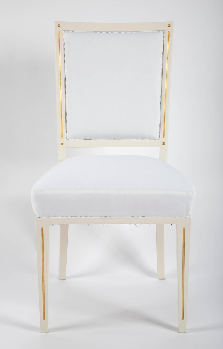 A large set of dining chairs designed for Bellevue Palace in Berlin by Carl-Heinz Schwennicke in 1958. All chairs have been refinished and upholstered in Muslin fabric.   Priced Individually at $1,800 Per Chair.
