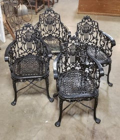 Set Of Early Cast Iron Arm Chairs by the Robert Wood Foundry