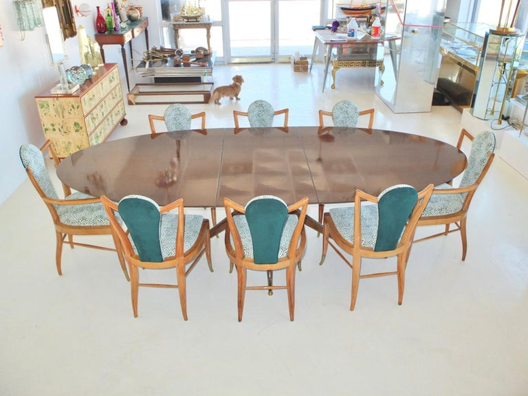 Sculptural dining chairs with strong lines and tapers designed and made by hand by Adolfo Genovese for F & G Hand Made Furniture Co. Cambridge, MA.  The chairs are sturdy and robust, constructed from two types of wood a light walnut and ash and have