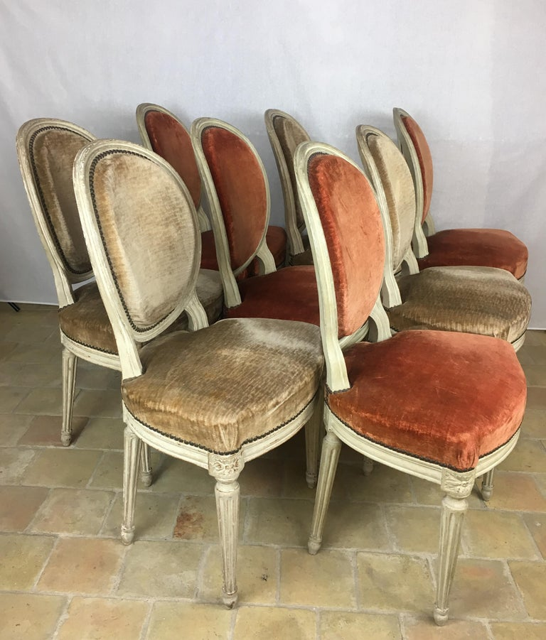 Fine set of 8 early 19th century Louis XVI Medaillon dining chairs. Very well constructed hand carved beechwood frames with their original patinated paint finish, velvet upholstery. These chairs are very strong and the wide seat very comfortable.