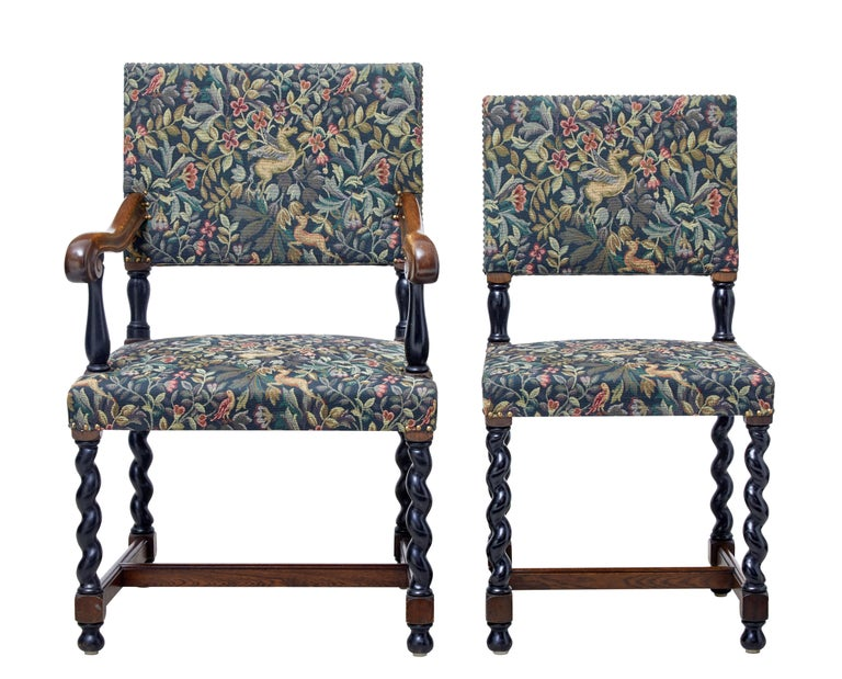 Good quality set of six single and two carver dining chairs circa 1890.  Recently upholstered in a William Morris style fabric and stud work.  Armchairs with scrolled arms, ebonized supports and barley twist legs. United by an 'h' frame