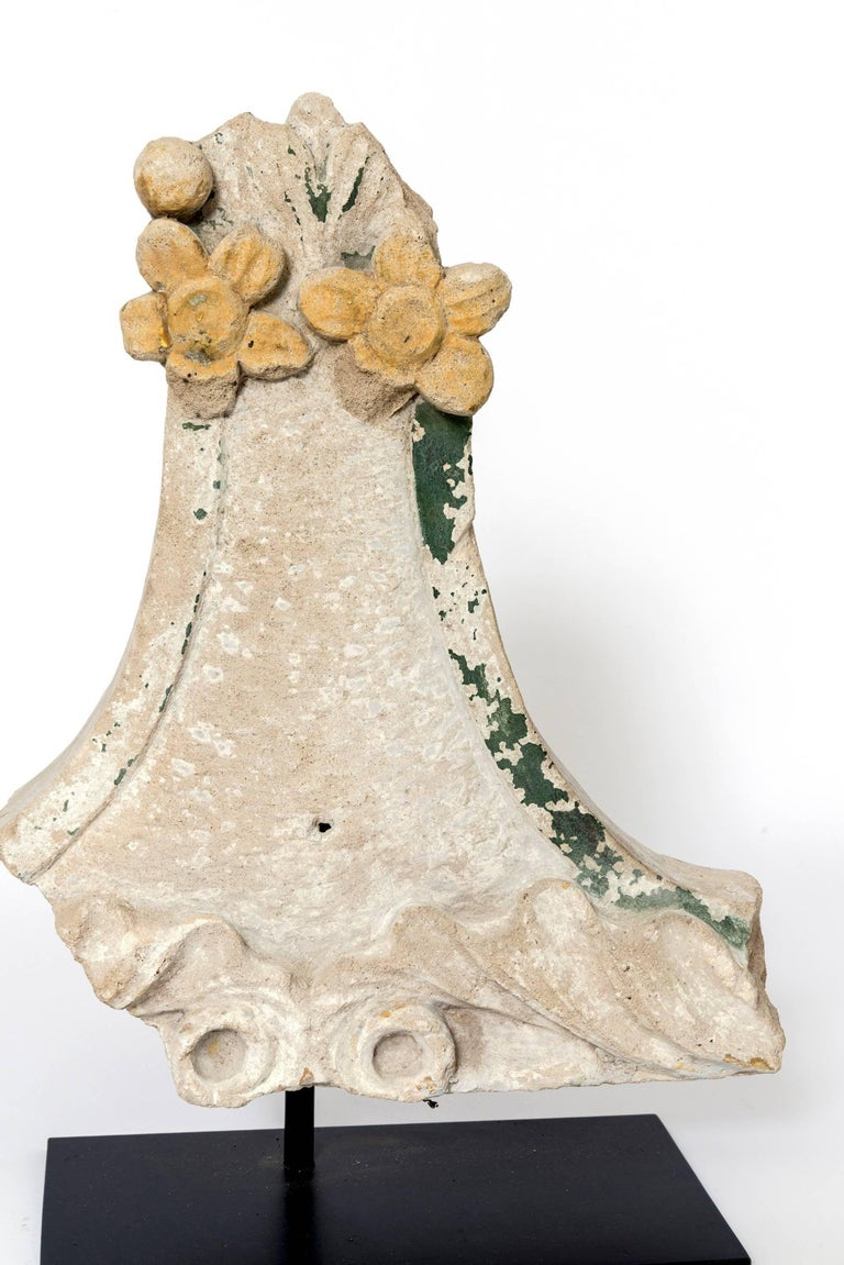 These are a wonderful display of varying floral patterns carved in stone with a goldenrod and green patina remaining on these. Various shapes and dimensions on these as a cluster look fantastic displayed together or separately.