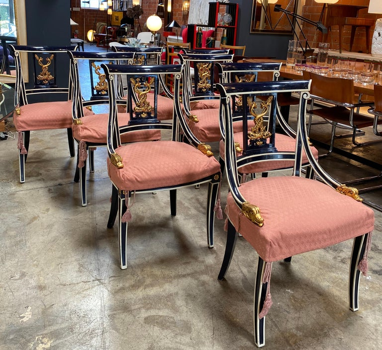 A splendid matched series of eight Venetian chairs dating from the mid-late 19th century. Stunning royal blue lacquered paint and golden water details and design on the chairs, with subtle brush strokes and a magnificent patina. The color is just