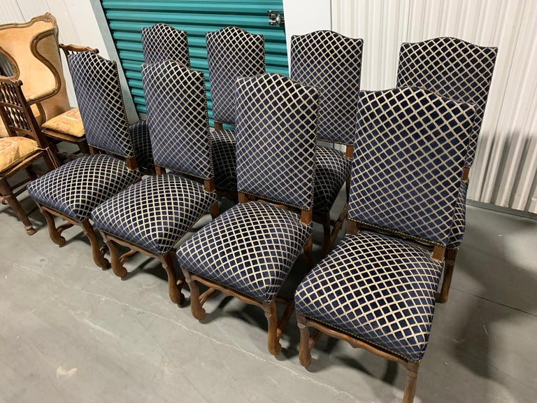 Set of eight 20th century French Louis XII Os de mouton upholstered dining chairs very comfortable all eight are side chairs.