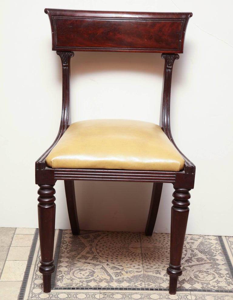 A set of eight American Classical mahogany dining chairs with reeding and turned and tapered legs.