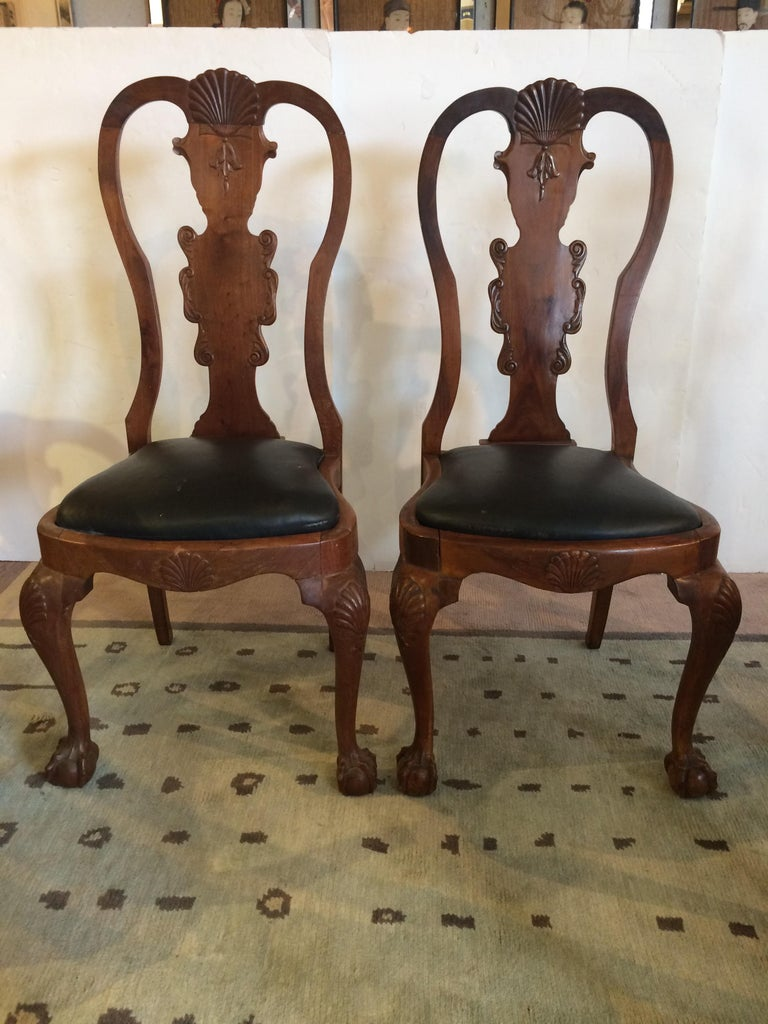 A wonderful antique set of mahogany Queen Anne style dining chairs with charm and character having two arm chairs and six side chairs. The arm chairs have curved arms with serpents as handle, all have shell motif decoration and ball and claw