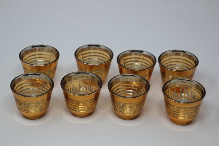 Set of six Arabic shot glasses with gold raised overlay design. Use these elegant glasses for Moroccan, Middle Eastern, Persian tea, or any hot or cold shot liquor drink. In fantastic condition, perfect for the holidays and gorgeous on display in a