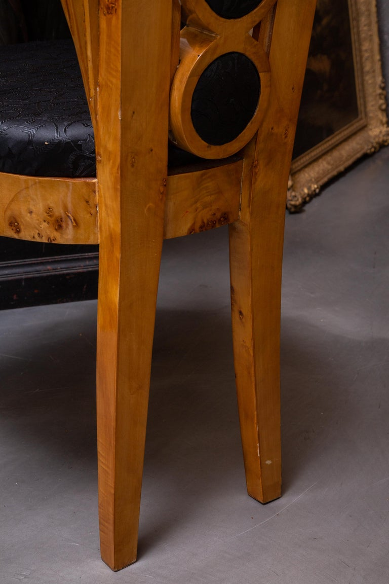 This is a unique set of eight Deco style birch dining chairs. The backs has a central section of fabric inset graduated concentric circles, flanked by fan-form structures above an upholstered seat and raised on straight tapered legs.