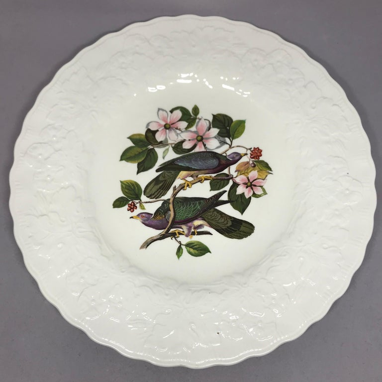 Set of eight Audubon birds of America plates in cream with raised floral border centering on eight different birds. Alfred Meakin, England, circa 1940. One cedar bird #43 One band tailed pigeon #62 One white crowned sparrow #114 One fork tailed