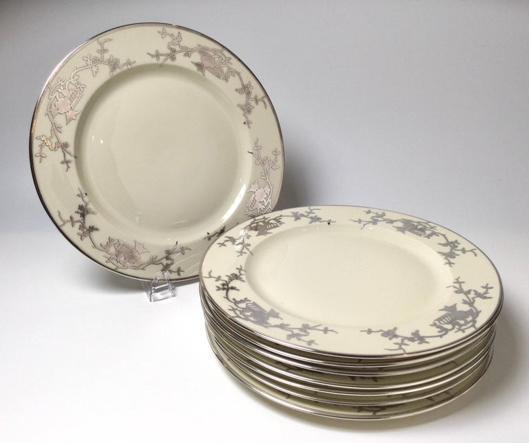 Elegant set off eight Bavarian chinoiserie silver overlay service dinner plates. Each with a chinoiserie sterling overlay decoration. Bavarian circa 1930s. Measure: 10 3/4