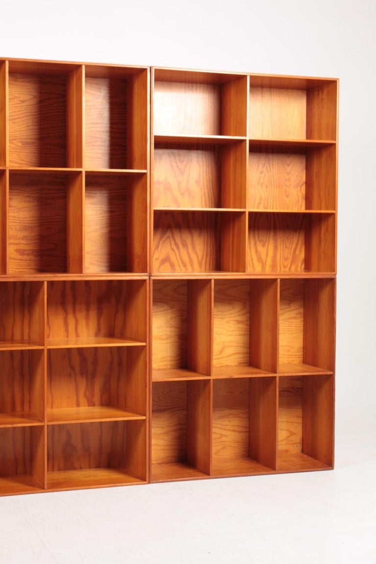8 matching bookcases in solid pine designed by Mogens Koch for Rud. Rasmussen cabinetmakers in 1933. Made in Denmark and in all original condition.