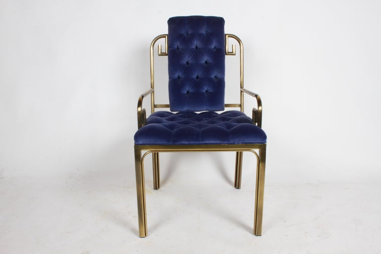 Beautiful matched set of eight brass frame Greek Key dining chairs by Mastercraft, circa 1970s. Shown with original blue velvet tufted seats, upholstery does have some stains. Should clean up okay, if professionally cleaned, if perfection is sought