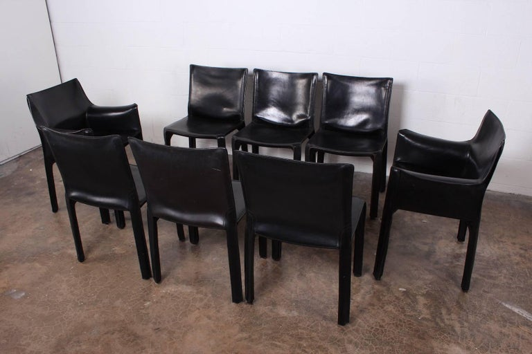A vintage set of eight black leather Cab armchairs designed by Mario Bellini for Cassina.