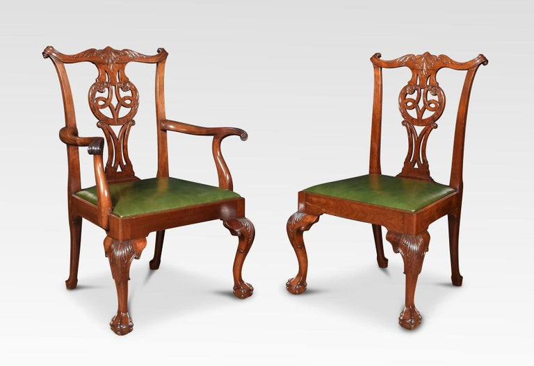 Set of eight mahogany dining chairs, the set consisting of two carvers and six single chairs. Each with yoked crest rail above a pierced splat with quatrefoil cut-outs over a drop-in green leather seat. All raised up on cabriole supports terminating