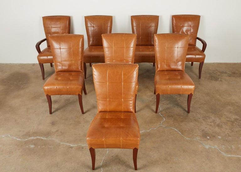 Magnificent set of eight leather dining chairs designed by Dakota Jackson. Known as puff chairs set consists of six side chairs and two armchairs. They feature a tufted leather pillow back in a rich cognac finish. The hardwood frames have a