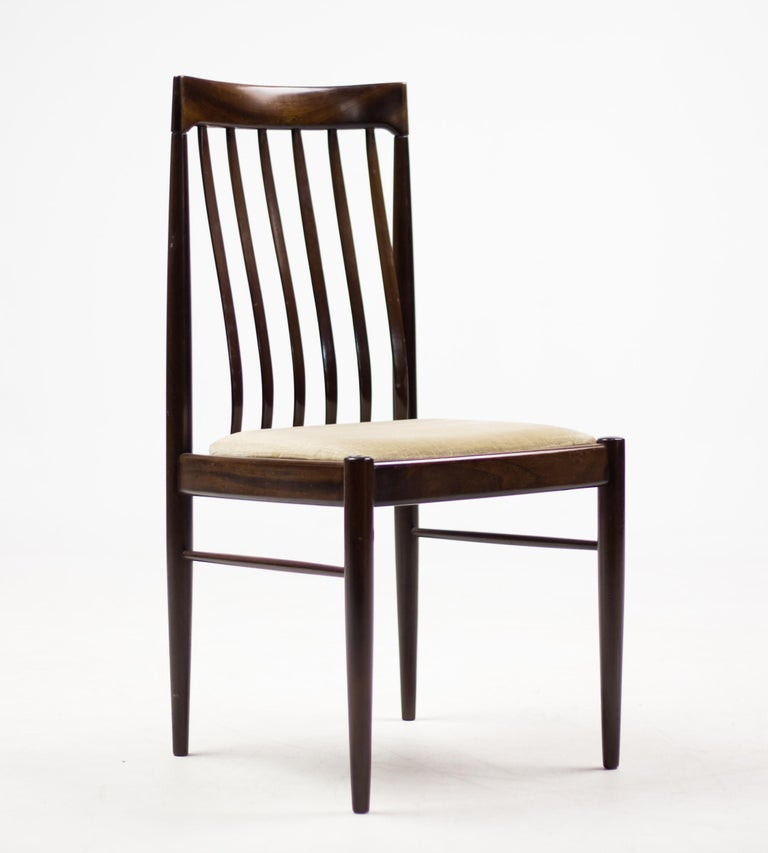 Excellent all original set of eight elegant dining chairs by Henry Walter Klein in mahogany with velvet seats.  Produced by Bramin Møbler in Denmark.  Marked with label.