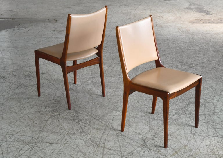 Mid-20th Century Set of Eight Danish Dining Chairs in Rosewood and Tan Leather by Johs Andersen For Sale