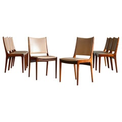 Set of Eight Danish Dining Chairs in Rosewood and Tan Leather by Johs Andersen