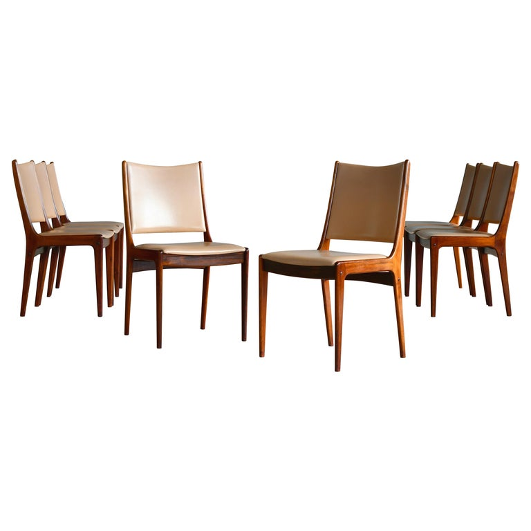 Set of Eight Danish Dining Chairs in Rosewood and Tan Leather by Johs Andersen For Sale