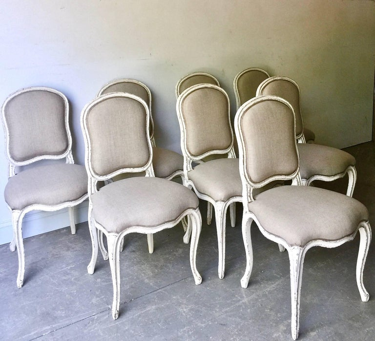 Early 20th Century Set of Eight Decoratively Carved French Louis XV Style Chairs For Sale